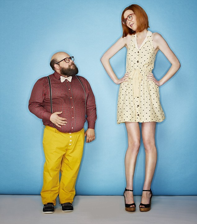 Tall woman and short man --- Image by © Tim Tadder/Corbis
